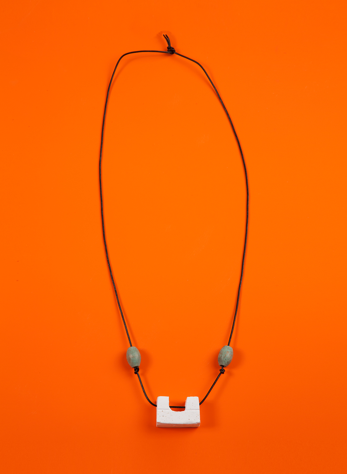 chadkouri-modularnecklace-orangebackground